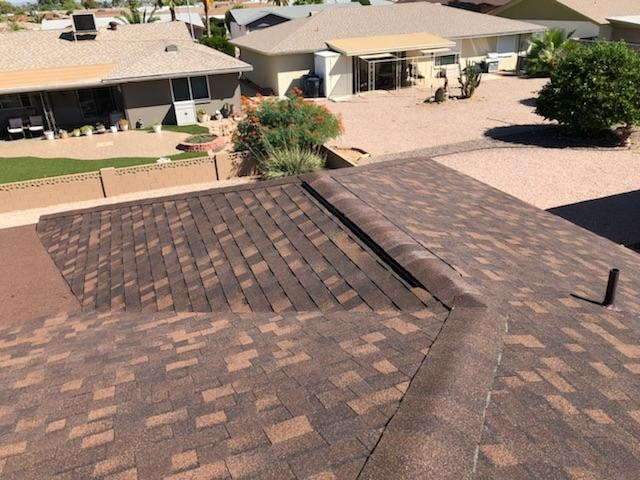 Owens Corning asphalt shingles installed by Johny's Roofing on a Dreamland Villa home